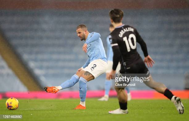 Kyle Walker of Manchester City passes the ball under pressure from Jack Grealish of Aston Villa during the Premier League match between Manchester...