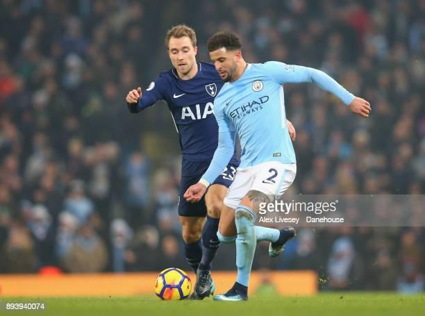 Kyle Walker of Manchester City passes the ball under pressure from Christian Eriksen of Tottenham Hotspur during the Premier League match between...