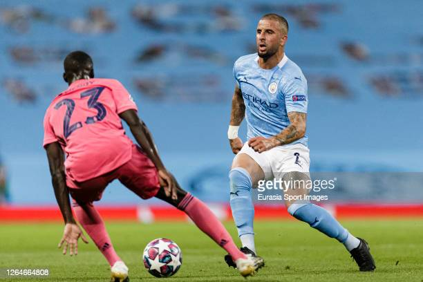 Kyle Walker of Manchester City plays against Ferland Mendy of Real Madrid during the UEFA Champions League round of 16 second leg match between...