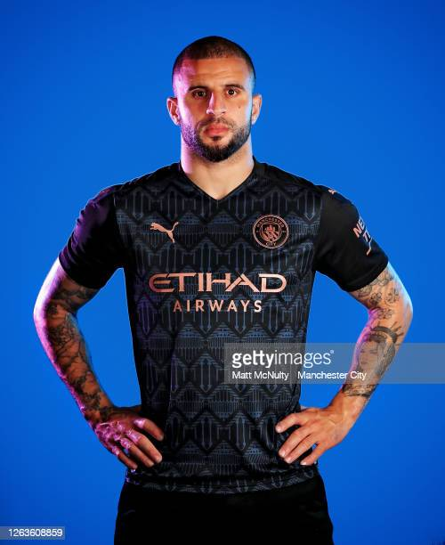 Kyle Walker of Manchester City poses wearing the 2020/21 Puma away jersey at the City Football Academy on August 03, 2020 in Manchester, England.
