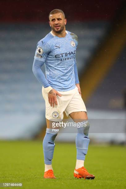 Kyle Walker of Manchester City reacts as he holds his leg due to injury during the Premier League match between Manchester City and Aston Villa at...