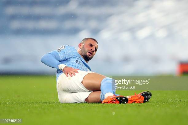 Kyle Walker of Manchester City reacts as he lays injured during the Premier League match between Manchester City and Aston Villa at Etihad Stadium on...