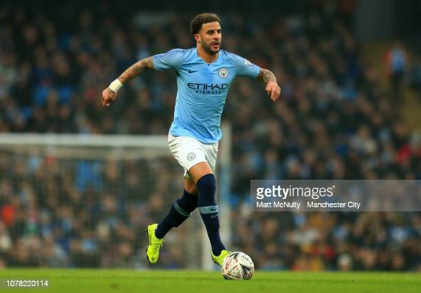 Kyle Walker of Manchester City runs with the ball during the FA Cup Third Round match between Manchester City and Rotherham United at the Etihad...
