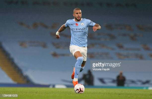 Kyle Walker of Manchester City runs with the ball during the Premier League match between Manchester City and Liverpool at Etihad Stadium on November...