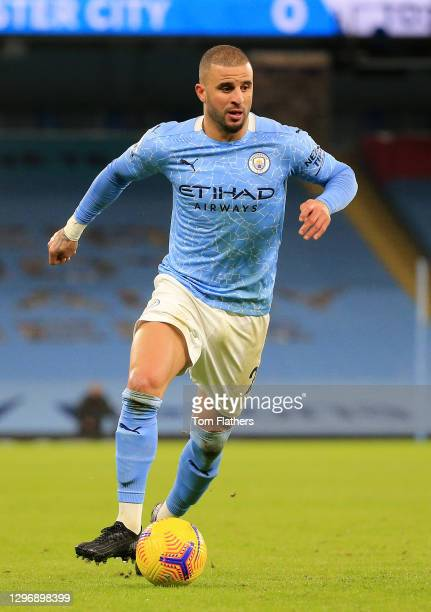 Kyle Walker of Manchester City runs with the ball during the Premier League match between Manchester City and Crystal Palace at Etihad Stadium on...