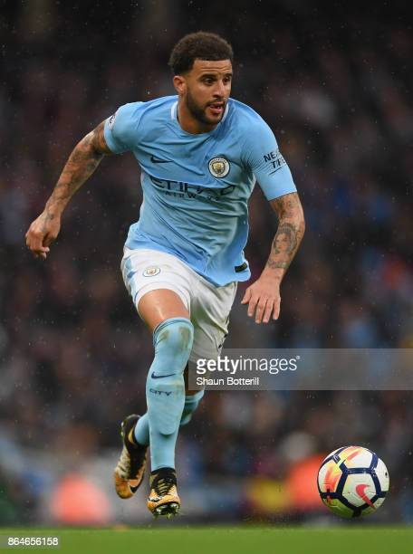 Kyle Walker of Manchester City runs with the ball during the Premier League match between Manchester City and Burnley at Etihad Stadium on October 21...