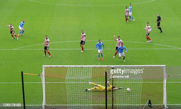 Kyle Walker of Manchester City scores his team's first goal past Aaron Ramsdale of Sheffield United during the Premier League match between Sheffield...