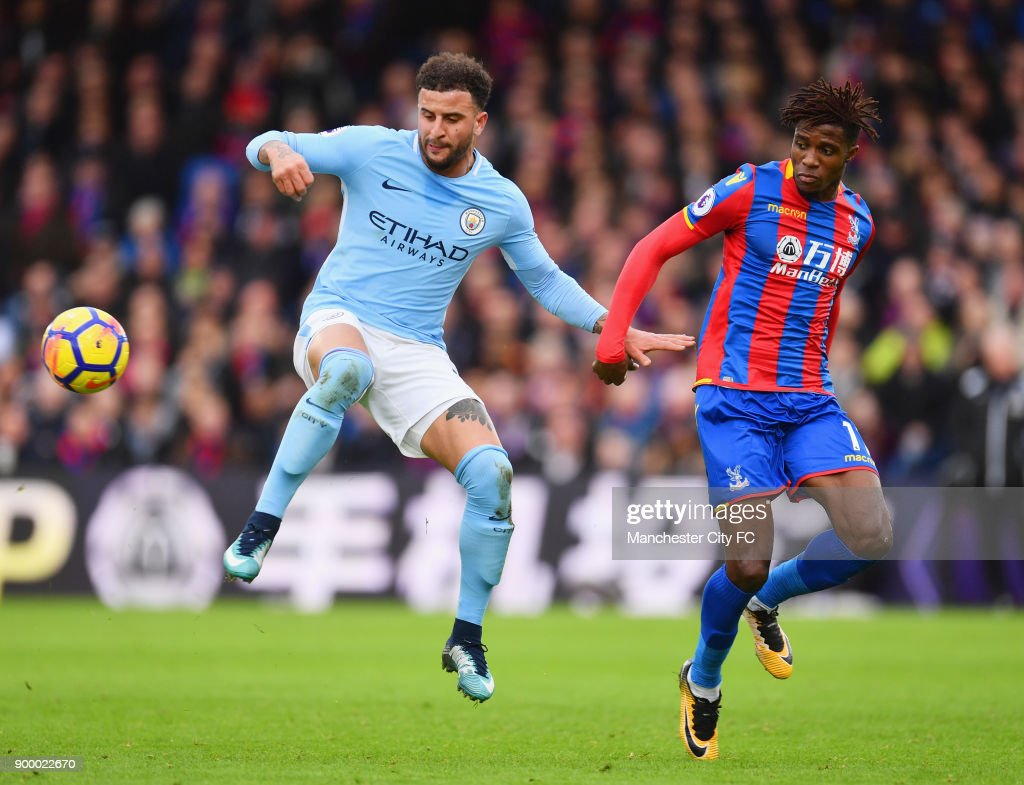 Kyle Walker of Manchester City shields from Wilfried Zaha of Crystal Palace during the Premier League match between Crystal Palace and Manchester City at Selhurst Park on December 31, 2017 in London, England.