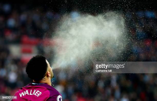 Kyle Walker of Manchester City spits out water before the Premier League match between Tottenham Hotspur and Manchester City at Wembley Stadium on...