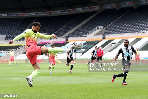 Kyle Walker of Manchester City stretches to control the ball during the FA Cup Quarter Final match between Newcastle United and Manchester City at...