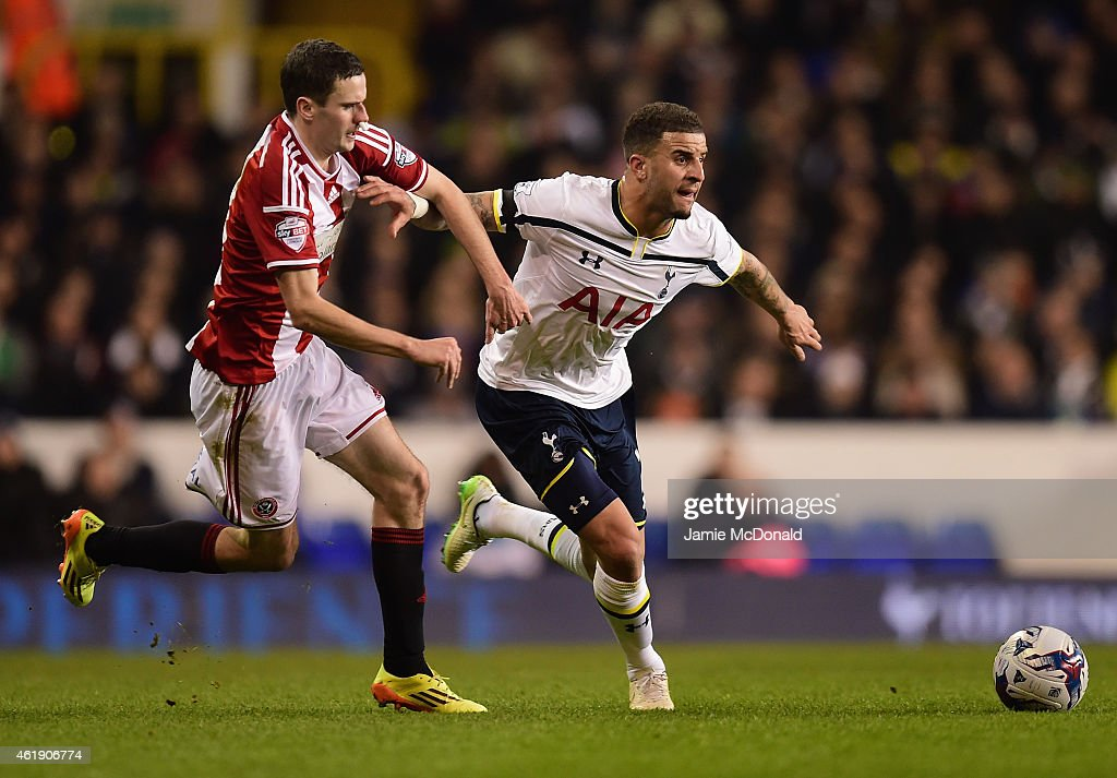 Kyle Walker of Spurs holds off a challenge from Jamie Murphy of Sheffield United during the Capital One Cup Semi-Final first leg match between Tottenham Hotspur and Sheffield United at White Hart Lane on January 21, 2015 in London, England.