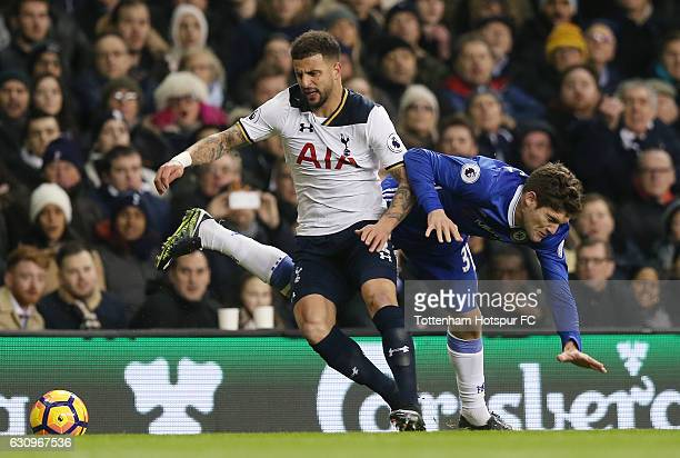 Kyle Walker of Tottenham Hotspur and Marcos Alonso of Chelsea battle for possession during the Premier League match between Tottenham Hotspur and...
