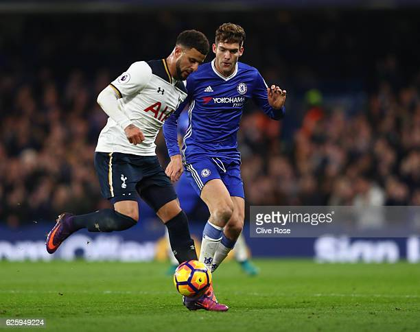 Kyle Walker of Tottenham Hotspur and Marcos Alonso of Chelsea compete for the ball during the Premier League match between Chelsea and Tottenham...