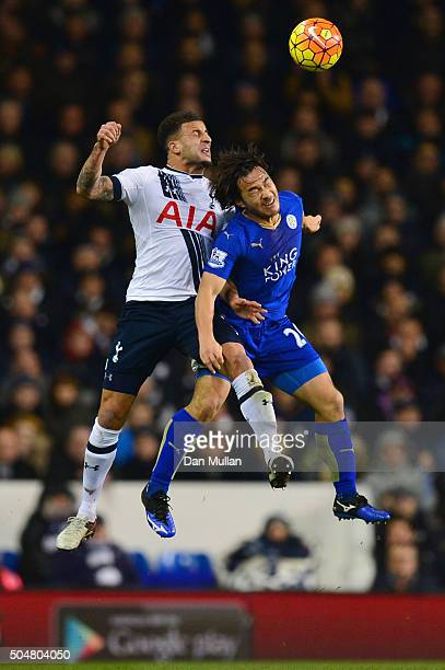 Kyle Walker of Tottenham Hotspur and Shinji Okazaki of Leicester City compete for the ball during the Barclays Premier League match between Tottenham...