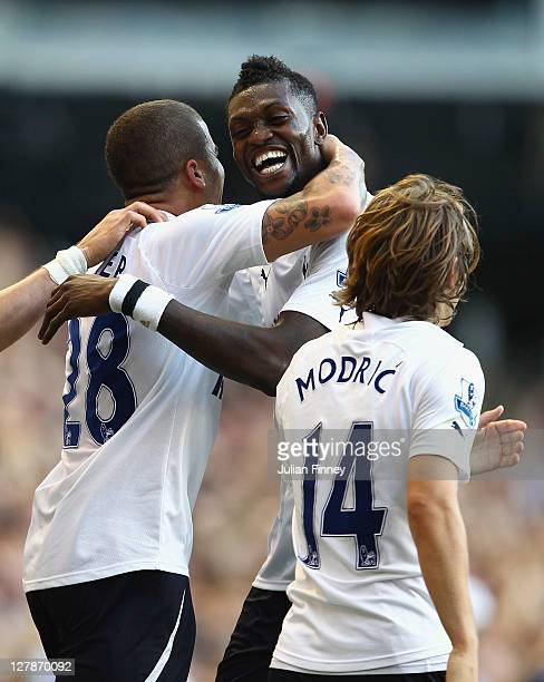 Kyle Walker of Tottenham Hotspur celebrates scoring his side's second goal with team mates Emmanuel Adebayor and Luka Modric during the Barclays...