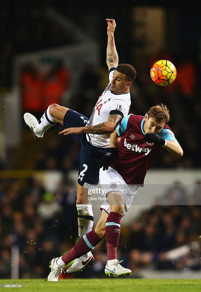 Kyle Walker of Tottenham Hotspur challenges for the ball with Nikica Jelavic of West Ham United during the Barclays Premier League match between Tottenham Hotspur and West Ham United at White Hart Lane on November 22, 2015 in London, England.