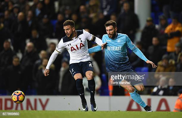Kyle Walker of Tottenham Hotspur holds of a challenge from Borja Baston of Swansea City during the Premier League match between Tottenham Hotspur and...