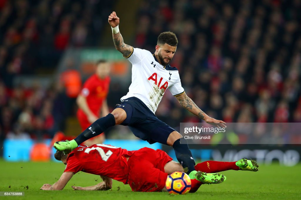 Kyle Walker of Tottenham Hotspur is challenged by Adam Lallana of Liverpool during the Premier League match between Liverpool and Tottenham Hotspur at Anfield on February 11, 2017 in Liverpool, England.