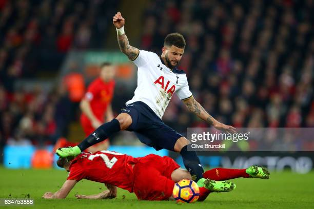 Kyle Walker of Tottenham Hotspur is challenged by Adam Lallana of Liverpool during the Premier League match between Liverpool and Tottenham Hotspur...