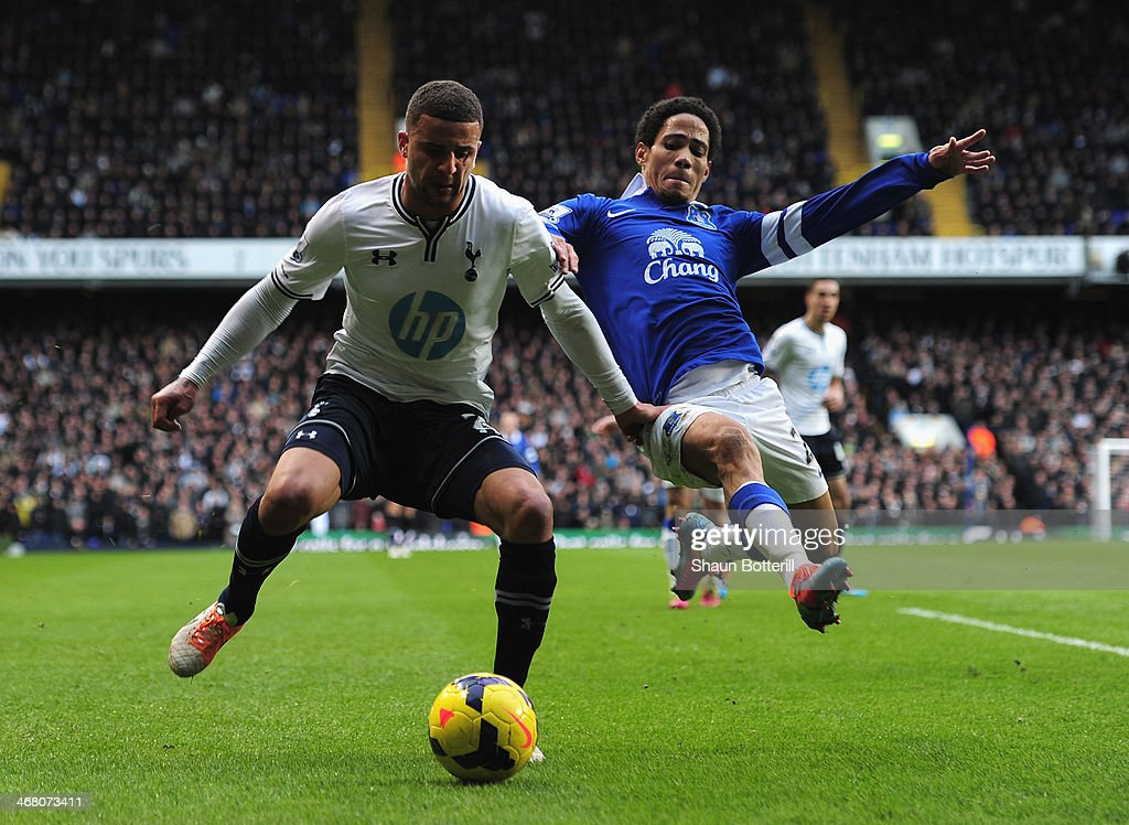 Kyle Walker of Tottenham Hotspur is challenged by Steven Pienaar of Everton during the Barclays Premier League match between Tottenham Hotspur and Everton at White Hart Lane on February 9, 2014 in London, England.