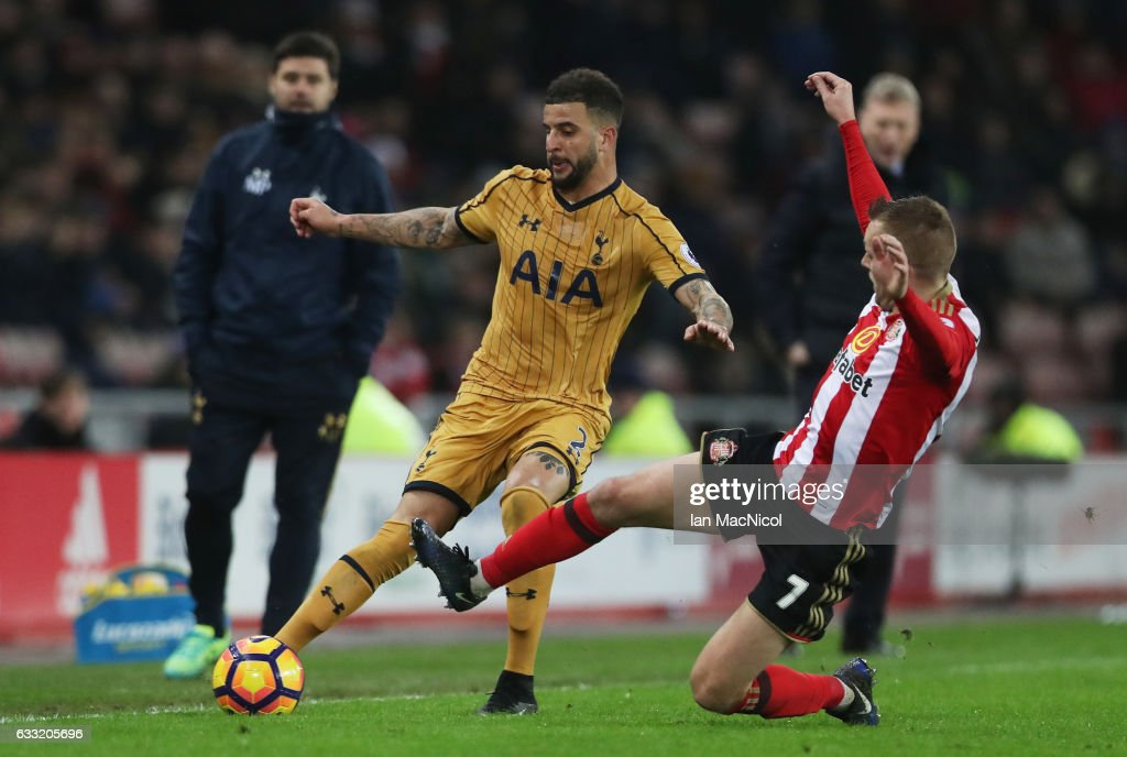 Kyle Walker of Tottenham Hotspur is tackled by Sebastian Larsson of Sunderland during the Premier League match between Sunderland and Tottenham Hotspur at Stadium of Light on January 31, 2017 in Sunderland, England.