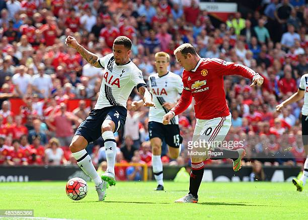 Kyle Walker of Tottenham Hotspur kicks the ball resulting in the own goal during the Barclays Premier League match between Manchester United and...