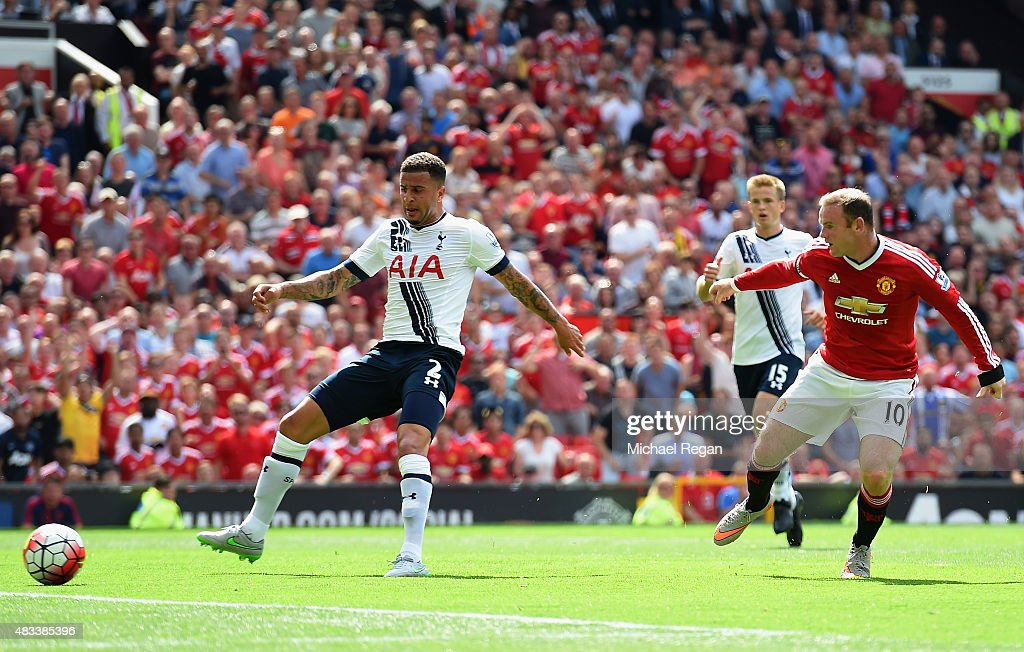 Kyle Walker (L) of Tottenham Hotspur kicks the ball resulting in the own goal during the Barclays Premier League match between Manchester United and Tottenham Hotspur at Old Trafford on August 8, 2015 in Manchester, England.