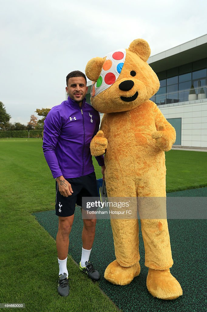 Kyle Walker of Tottenham Hotspur meets Children In Need's Pudsey Bear at the club's training ground on October 28, 2015 in Enfield, England.