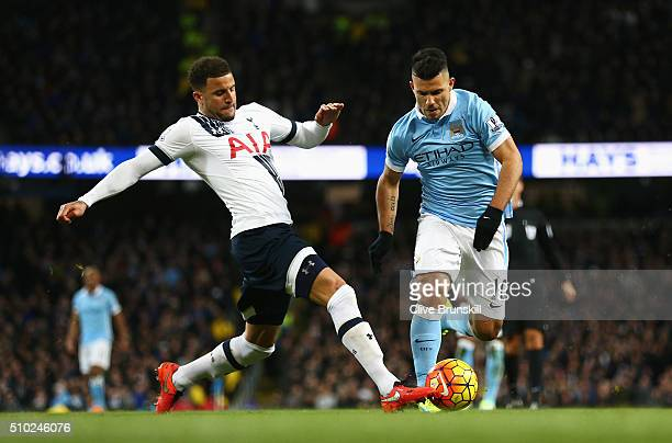 Kyle Walker of Tottenham Hotspur tackles Sergio Aguero of Manchester City during the Barclays Premier League match between Manchester City and...