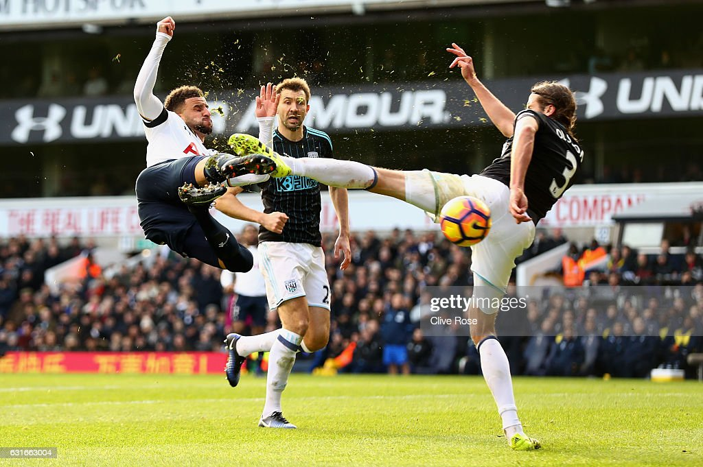 Kyle Walker of Tottenham Hotspur (L) volleys while Jonas Olsson of West Bromwich Albion (R) attempts to block during the Premier League match between Tottenham Hotspur and West Bromwich Albion at White Hart Lane on January 14, 2017 in London, England.