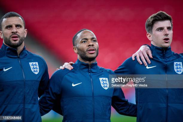 Kyle Walker, Raheem Sterling and Masount Mount of England sing the national anthem during the FIFA World Cup 2022 Qatar qualifying match between...