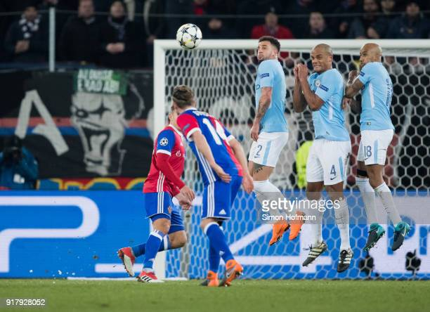 Kyle Walker Vincent Kompany and Fabian Delph of Manchester City during a free kick during the UEFA Champions League Round of 16 First Leg match...