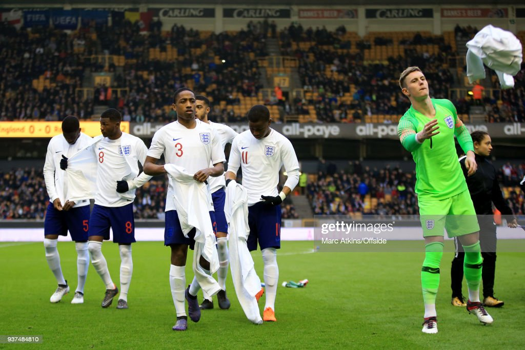 Kyle Walker-Peters and Dean Henderson of England lead their team mates as they discard their tracksuits during the U21 International Friendly match between England U21 and Romania U21 at Molineux on March 24, 2018 in Wolverhampton, England.