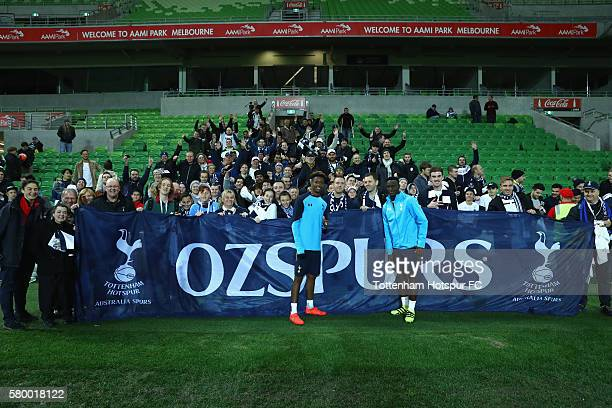 Kyle WalkerPeters and Victor Wanyama pose with fans during a Tottenham Hotspur training session at AAMI Park on July 25 2016 in Melbourne Australia