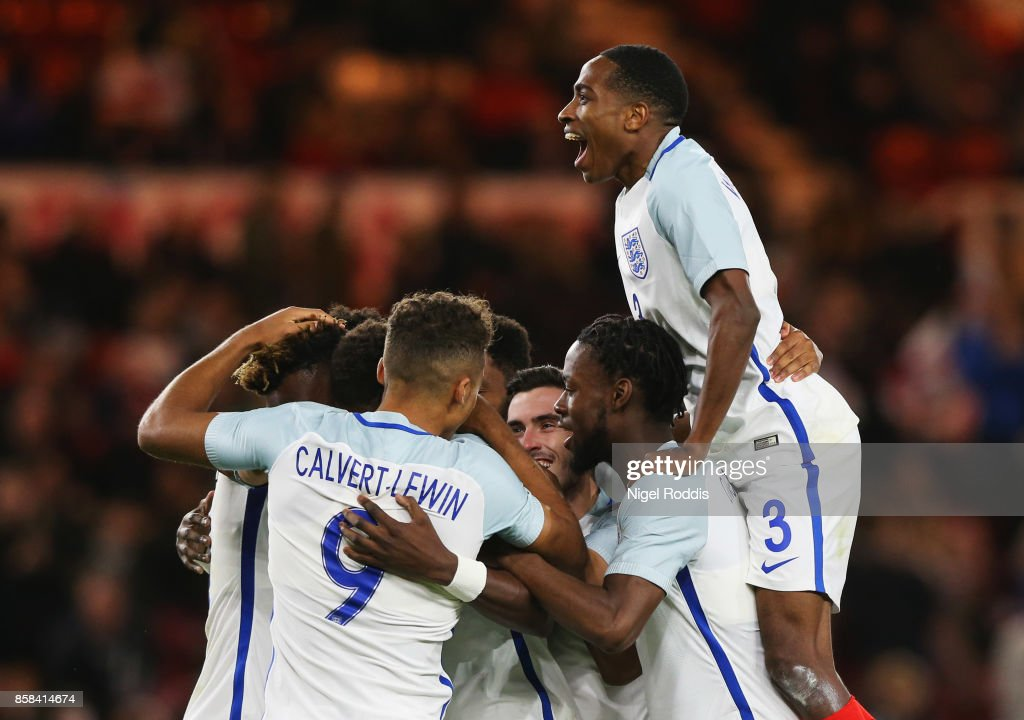 Kyle Walker-Peters of England (3) and team mates congratulate Tammy Abraham of England (obscured) as he scores their second goal from a penalty during the UEFA European Under 21 Championship Group 4 Qualifier between England and Scotland at Riverside Stadium on October 6, 2017 in Middlesbrough, England.
