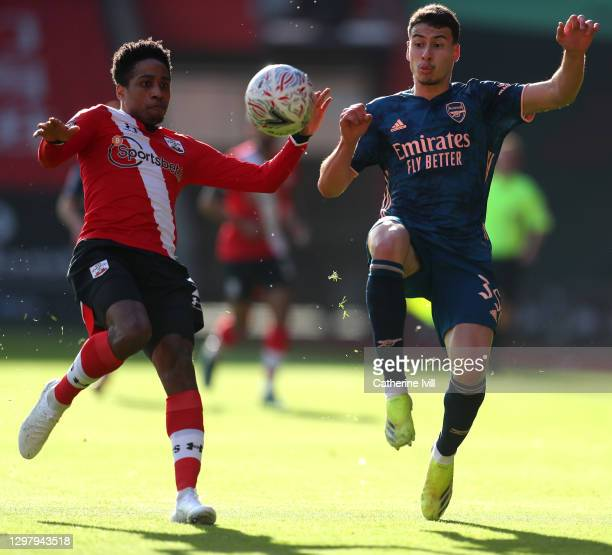 Kyle Walker-Peters of Southampton battles for possession with Gabriel Martinelli of Arsenal during The Emirates FA Cup Fourth Round match between...