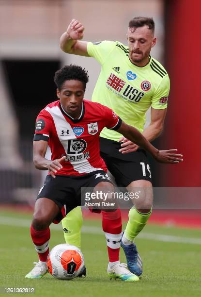 Kyle WalkerPeters of Southampton battles for possession with Jack Robinson of Sheffield United during the Premier League match between Southampton FC...