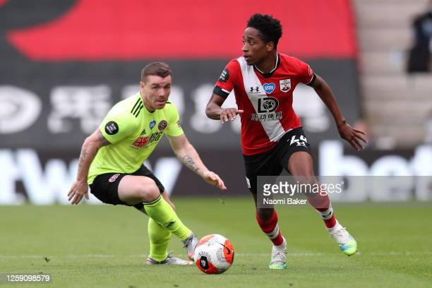 Kyle WalkerPeters of Southampton battles for possession with John Fleck of Sheffield United during the Premier League match between Southampton FC...
