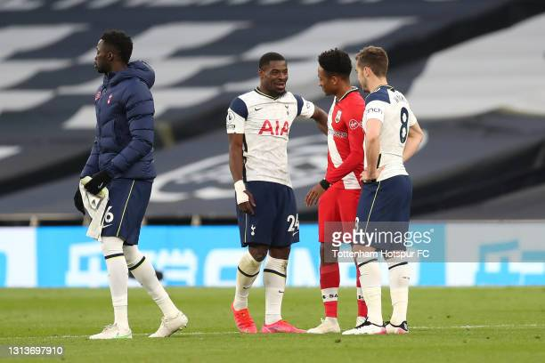 Kyle Walker-Peters of Southampton interacts with Serge Aurier and Harry Winks of Tottenham Hotspur after the Premier League match between Tottenham...