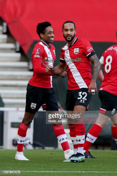 Kyle Walker-Peters of Southampton is congratulated by team-mate Theo Walcott after his shot is deflected by Gabriel of Arsenal to concede an own goal...