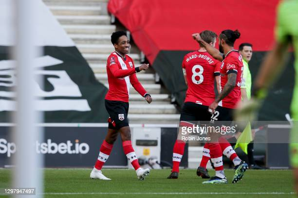 Kyle Walker-Peters of Southampton is congratulated by team-mate Theo Walcott and James Ward-Prowse after his shot is deflected by Gabriel of Arsenal...