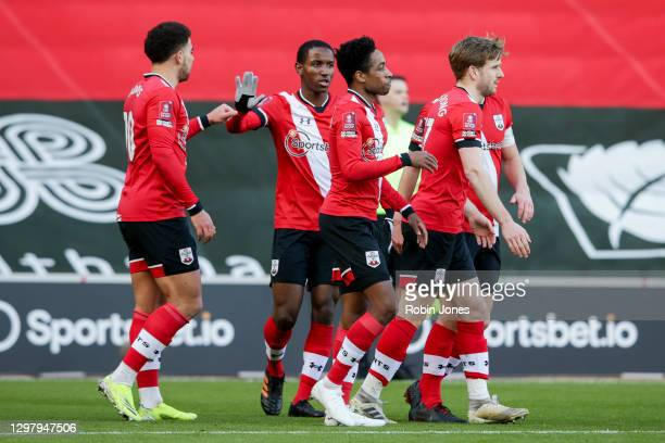 Kyle Walker-Peters of Southampton is congratulated by team-mates after his shot is deflected by Gabriel of Arsenal to concede an own goal during...