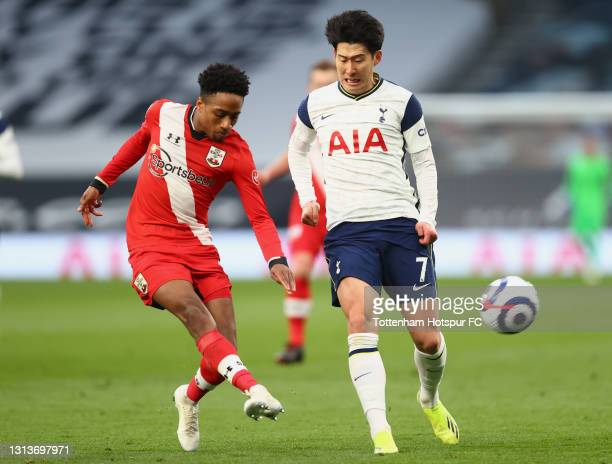 Kyle Walker-Peters of Southampton makes a pass whilst under pressure from Son Heung-Min of Tottenham Hotspur during the Premier League match between...