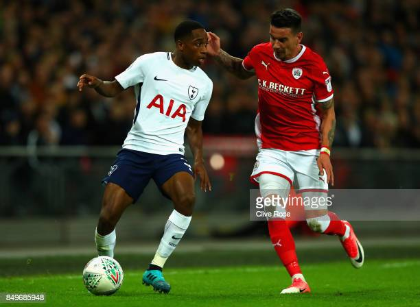 Kyle WalkerPeters of Tottenham Hotspur and Adam Hammill of Barnsley during the Carabao Cup Third Round match between Tottenham Hotspur and Barnsley...