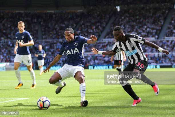 Kyle WalkerPeters of Tottenham Hotspur and Christian Atsu of Newcastle United during the Premier League match between Newcastle United and Tottenham...
