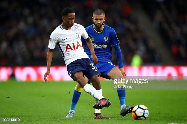 Kyle WalkerPeters of Tottenham Hotspur and George Francomb of AFC Wimbledon during The Emirates FA Cup Third Round match between Tottenham Hotspur...