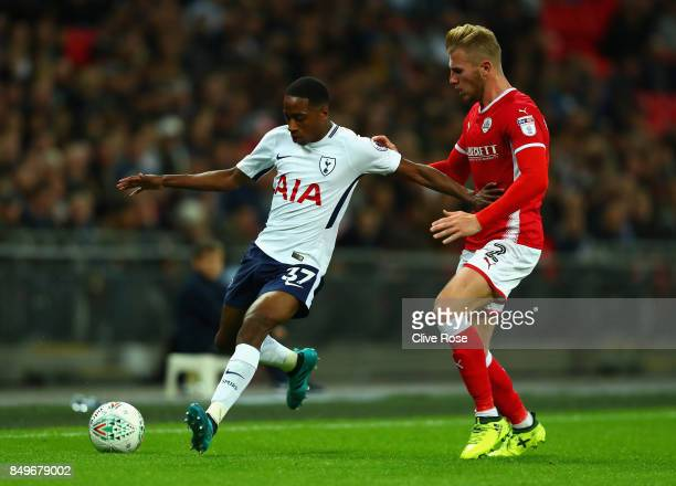 Kyle WalkerPeters of Tottenham Hotspur and Jason McCarthy of Barnsley battle for possession during the Carabao Cup Third Round match between...
