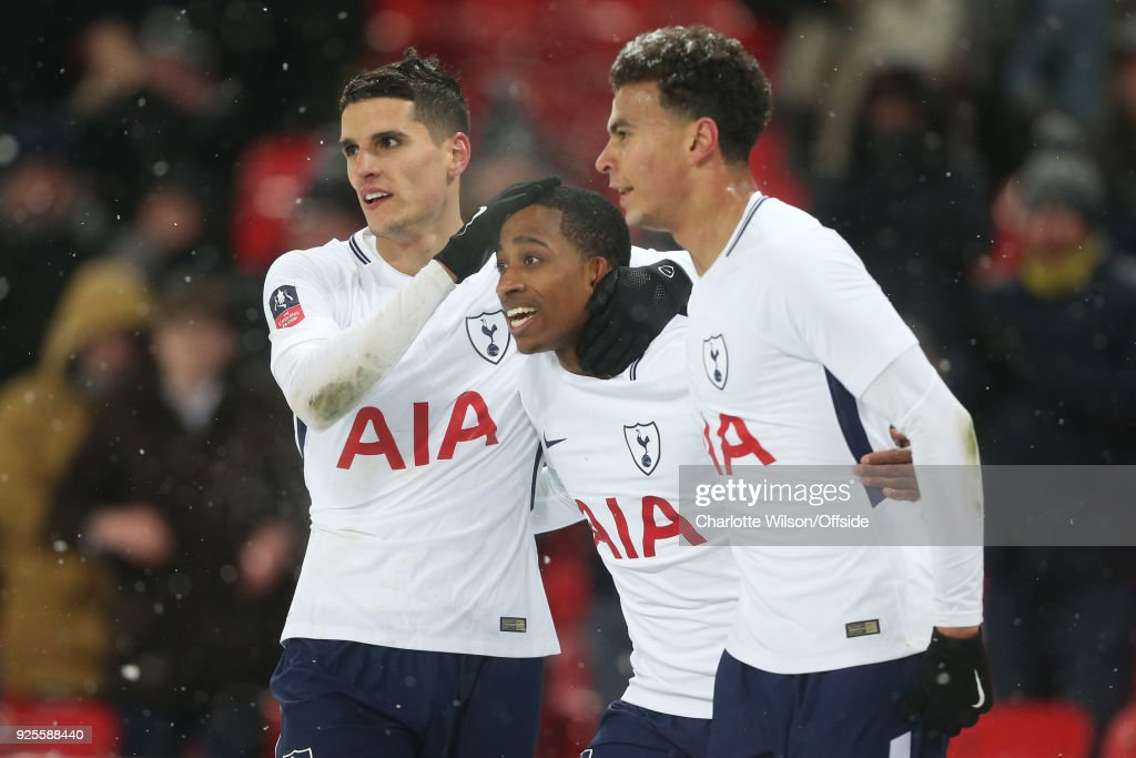 Kyle Walker-Peters of Tottenham Hotspur celebrates his goal with Erik Lamela and Dele Alli during the Emirates FA Cup Fifth Round Replay match between Tottenham Hotspur and Rochdale at Wembley Stadium on February 28, 2018 in London, United Kingdom.