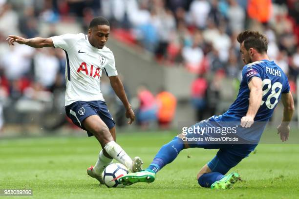 Kyle WalkerPeters of Tottenham is tackled by Christian Fuchs of Leicester during the Premier League match between Tottenham Hotspur and Leicester...
