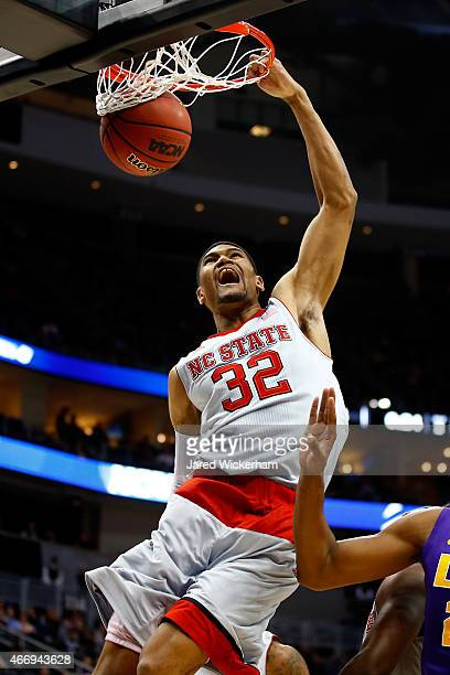 Kyle Washington of the North Carolina State Wolfpack dunks the ball against the LSU Tigers in the second half against the LSU Tigers during the...
